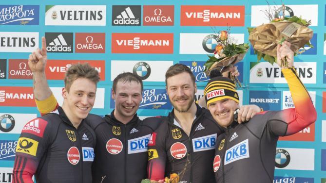 Экипаж Максимилиана Арндта (на фото - справа) празднует победу на чемпионате мира, AP