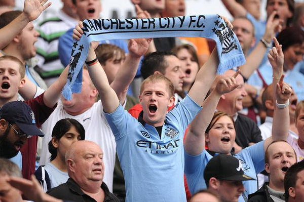 A Manchester City fan shows his support in the stands during the FA Community Shield at Villa Park